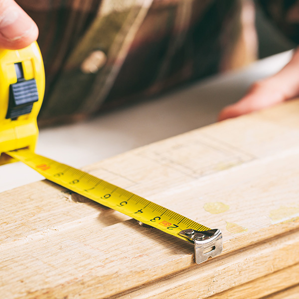 measuring timber boards
